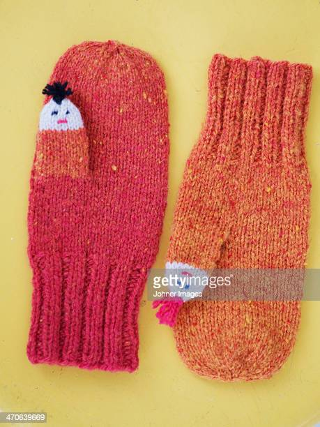 mittens on yellow background, studio shot - mitten stock pictures, royalty-free photos & images