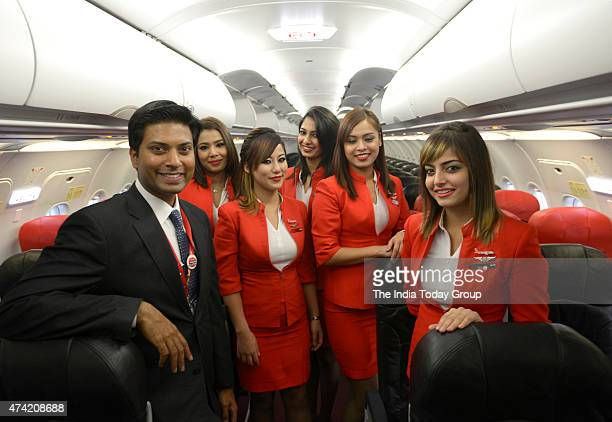 Mittu Chandilya CEO of Air Asia India with Air Hostess inside the Aeroplane during Air Asia flight Launch in IGI AirportT3 New Delhi