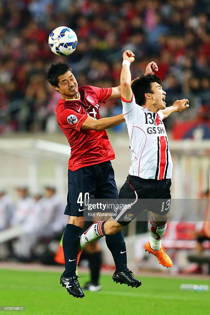 Mituo Ogasawara #20 of Kashima Antlers in action during the AFC Champions League Group H match between Kashima Antlers and FC Seoul at Kashima Stadium on May 5, 2015 in Kashima, Japan.