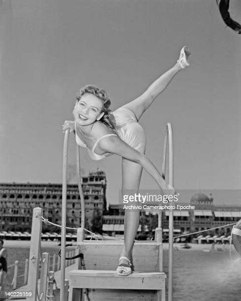 Mitzi Hunter, one of the Merriel Abbott Dancers, poses in front of the Hotel Excelsior, on the Venice Lido, Italy, 1950.