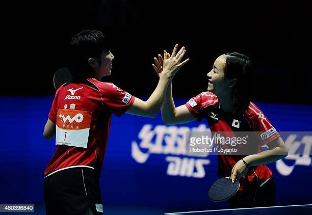 Miu Hirano and Mima Ito of Japan celebrate their win after defeating Feng Tian Wei and Yu Meng Yu of Singapore during the Women's Doubles semi final...
