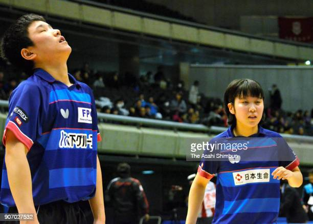 Miu Hirano and Tomokazu Harimoto react after a point in the Mixed Doubles Round of 16 match during day three of the All Japan Table Tennis...