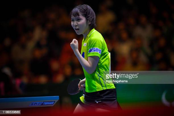 Miu Hirano of Japan celebrates a point against Jeon Jihee of Korea Republic during Women's Teams singles - Semifinals - Match 2 on day four of the...