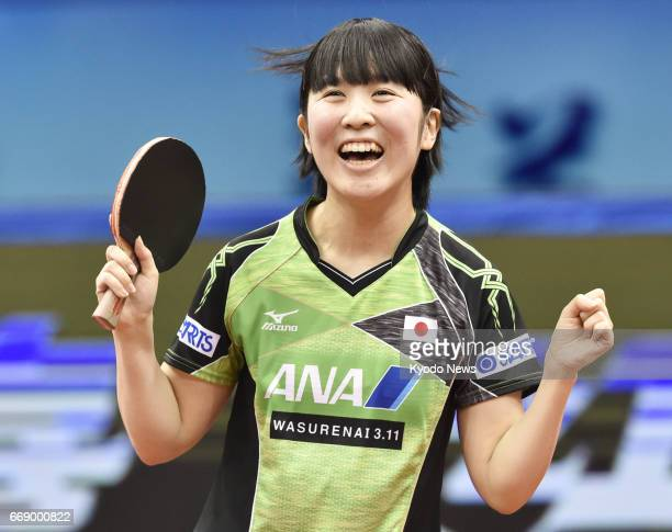 Miu Hirano of Japan celebrates after beating world No 5 Cheng Ming of China in the women's final of the Asian table tennis championships in Wuxi in...