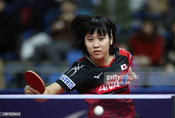 Miu Hirano of Japan competes against Kasumi Ishikawa of Japan in the Women's Singles - Round of 16 during day one of the World Tour Grand Finals at...