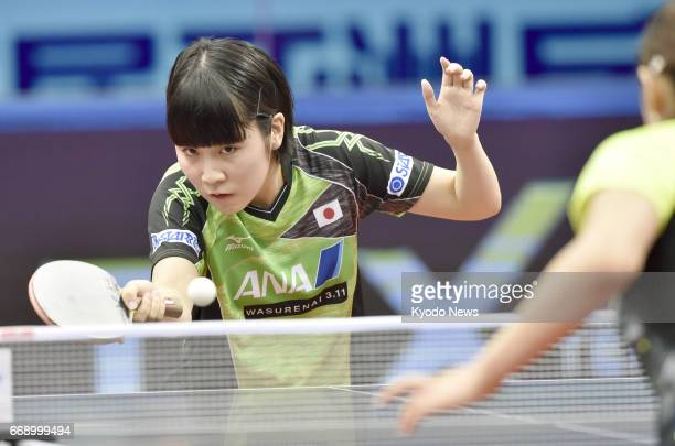 Miu Hirano of Japan plays against world No. 5 Cheng Ming of China in the women's final of the Asian table tennis championships in Wuxi in China's...