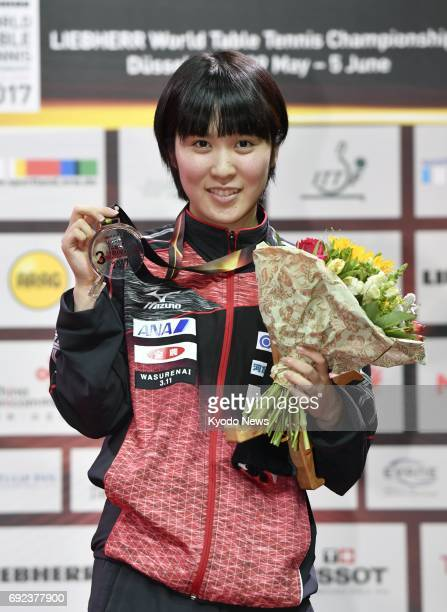 Miu Hirano of Japan poses on the podium in Dusseldorf Germany on June 4 2017 after taking the women's singles bronze medal at the world table tennis...