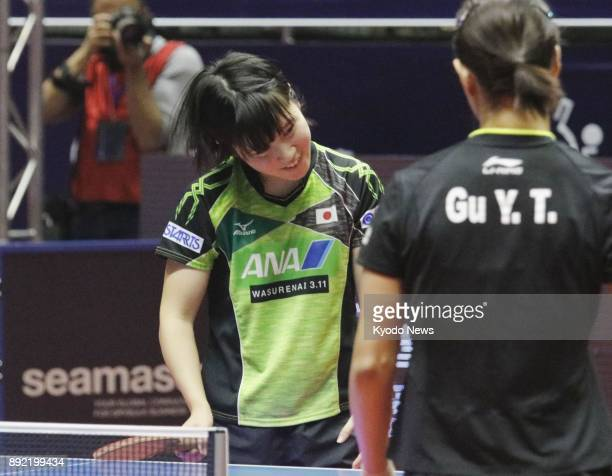 Miu Hirano of Japan reacts after losing to Gu Yuting of China 43 in the first round of the women's singles at the table tennis World Tour Grand...