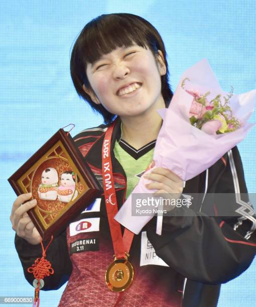 Miu Hirano of Japan smiles during an award ceremony after beating world No 5 Cheng Ming of China in the women's final of the Asian table tennis...