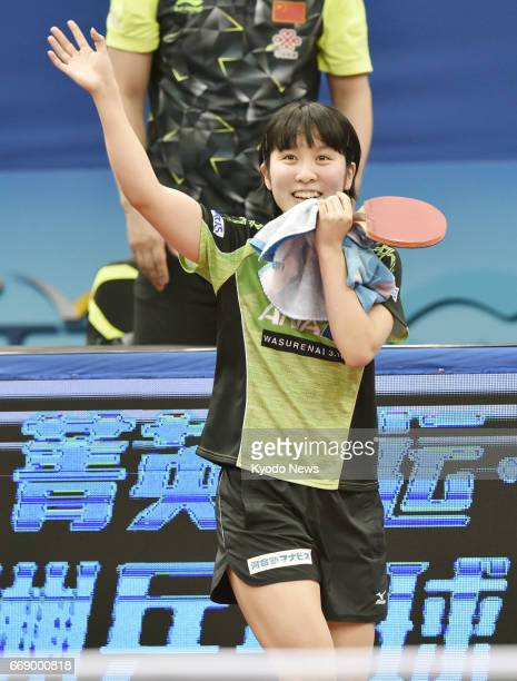 Miu Hirano of Japan waves to the crowd after beating world No 5 Cheng Ming of China in the women's final of the Asian table tennis championships in...