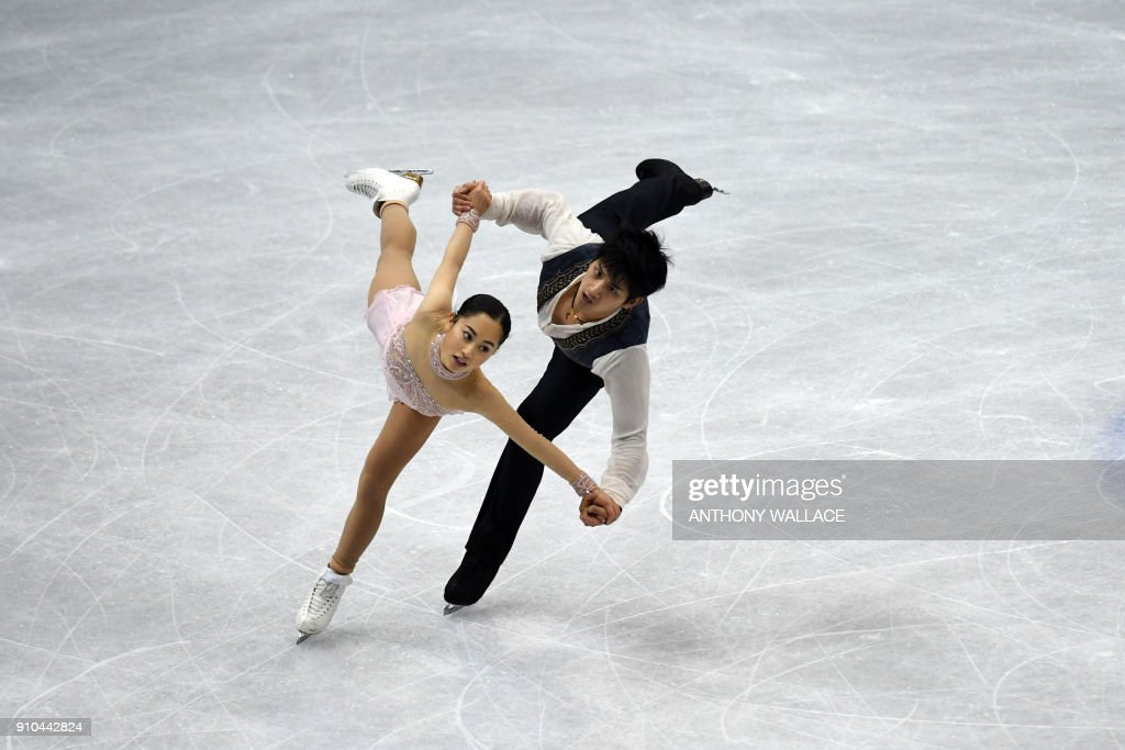 Miu Suzaki and Ryuichi Kihara of Japan perform in the pairs free skating program at the ISU Four Continents figure skating championships in Taipei on January 26, 2018. / AFP PHOTO / Anthony WALLACE
