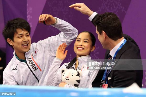 Miu Suzaki and Ryuichi Kihara of Japan react to their score at the kiss and cry after competing during the Pair Skating Short Program on day five of...