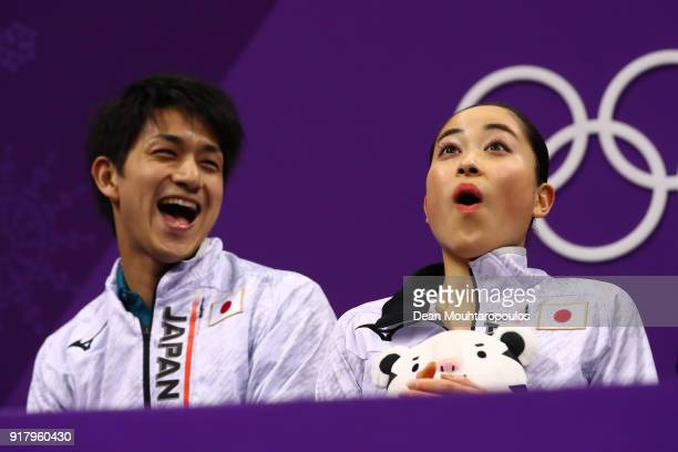 Miu Suzaki and Ryuichi Kihara of Japan react to their score during the Pair Skating Short Program on day five of the PyeongChang 2018 Winter Olympics...