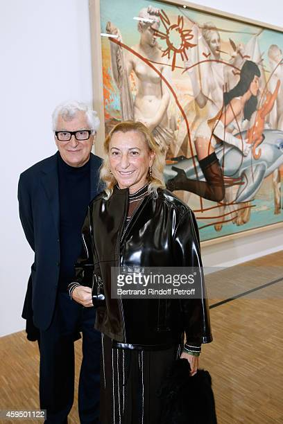Miuccia Prada and her husband attend the 'Jeff Koons' Retrospective Exhibition Private Visit at Beaubourg on November 23 2014 in Paris France