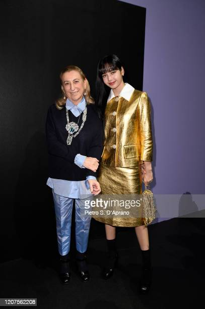 Miuccia Prada and Lisa from Blackpink attends the Prada show during Milan Fashion Week Fall/Winter 2020/2021 on February 20 2020 in Milan Italy