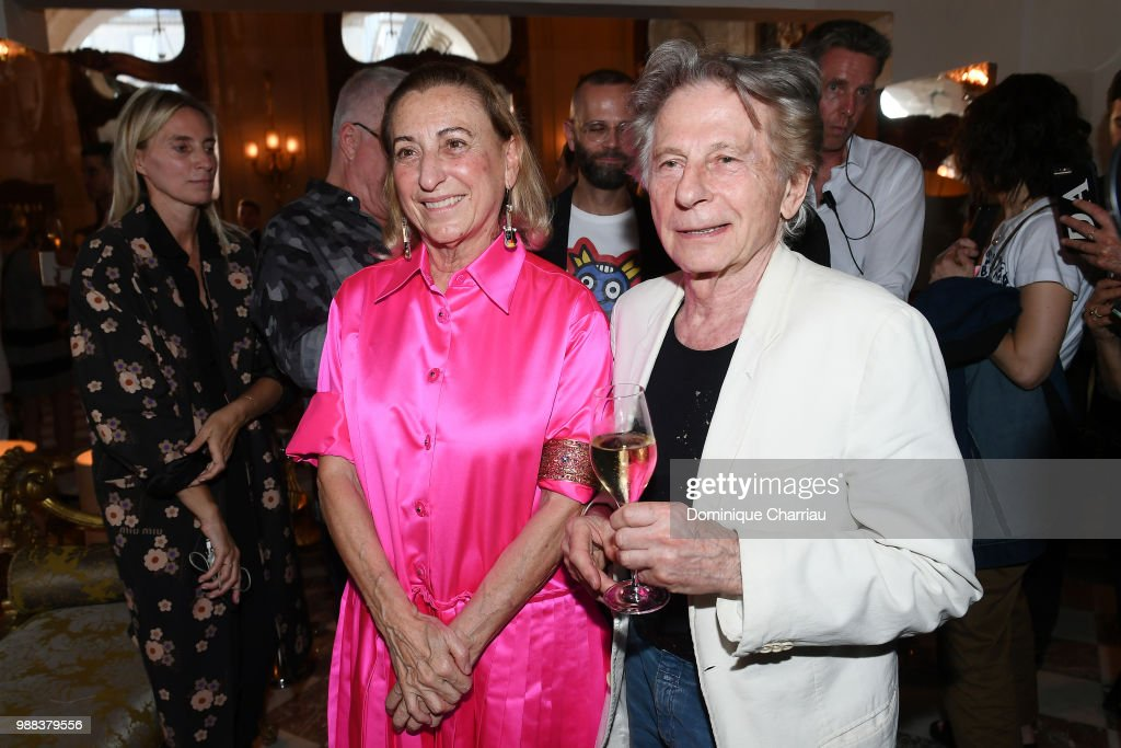 miuccia-prada-and-roman-polanski-attend-miu-miu-2019-cruise-show-at-picture-id988379556