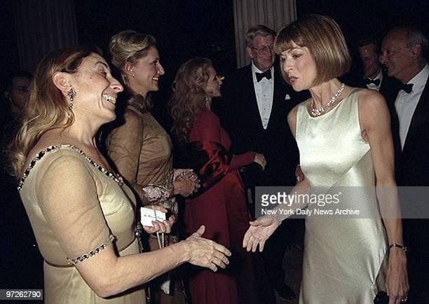 Miuccia Prada greets Anna Wintour during the 50th Anniversary of the Costume Institute Gala at the Metropolitan Museum of Art