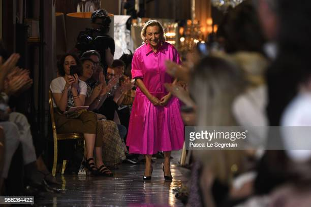 Miuccia Prada greets the crowd on the runway during Miu Miu 2019 Cruise Collection Show at Hotel Regina on June 30 2018 in Paris France