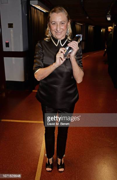 Miuccia Prada poses backstage at The Fashion Awards 2018 in partnership with Swarovski at the Royal Albert Hall on December 10, 2018 in London,...
