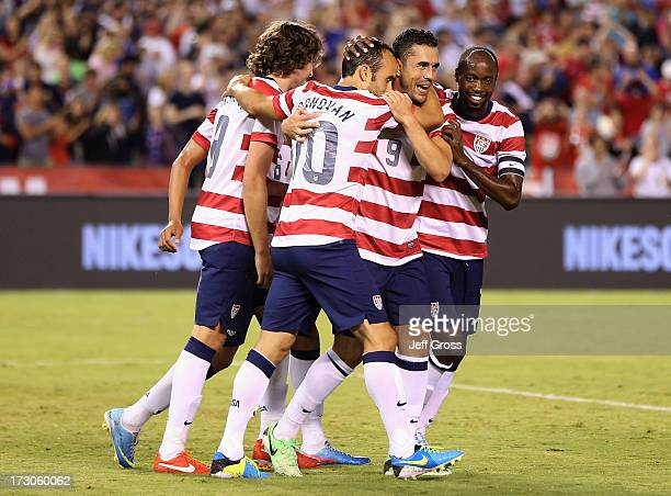 Mix Diskerud Landon Donovan Herculez Gomez and DaMarcus Beasley of the USA celebrate Donovan's goal against Guatemala in the second half at Qualcomm...