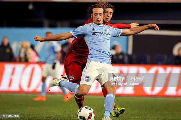 Mix Diskerud NYCFC is challenged by Matt Polster Chicago Fire in action during the New York City FC Vs Chicago Fire MLS regular season match at...