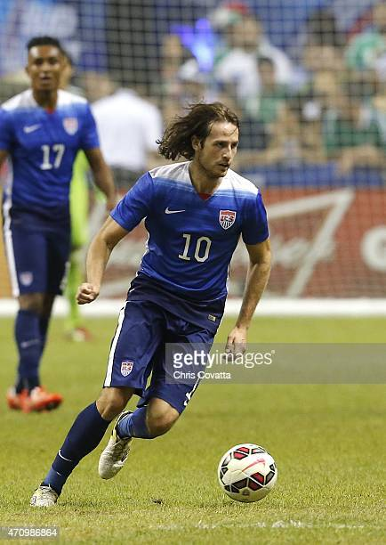 Mix Diskerud of the United States advances the ball against Mexico during an international friendly match at the Alamodome on April 15 2015 in San...