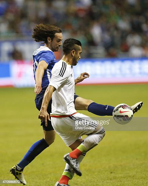 Mix Diskerud of the United States battles for the ball with Mario Osuna of Mexico during an international friendly match at the Alamodome on April 15...