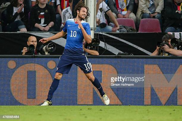 Mix Diskerud of the USA celebrates his team's first goal during the International Friendly match between Germany and USA at RheinEnergieStadion on...