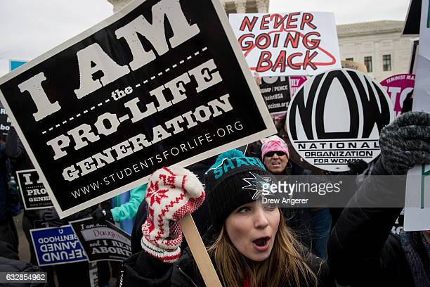 A mix of antiabortion advocates and prochoice advocates rally outside of the Supreme Court during the March for Life January 27 2017 in Washington DC...