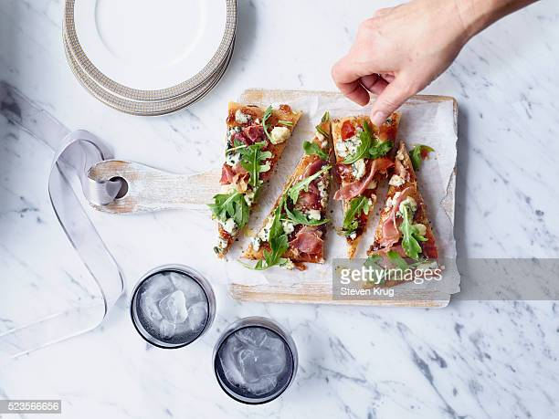 Mix of arugula, prosciutto, blue cheese and fig jam, spread on toasted Greek pita