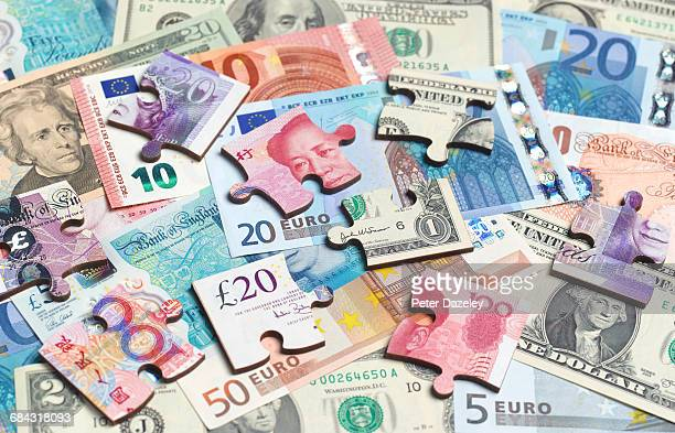 Mix of currencies jigsaw pieces