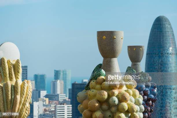 A mix of Gaudi sculptures and city buildings making up the city skyline seen from top of Sagrada Familia Barcelona Spain