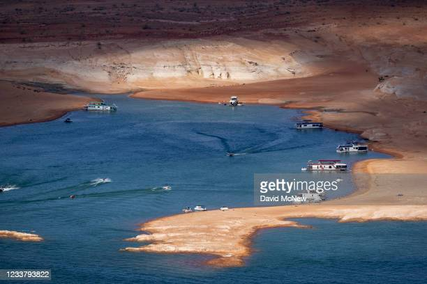 """Mix of red sand and the white """"bathtub ring"""" of previously submerged rock, indicating record low water levels at Lake Powell, are seen as the drought..."""