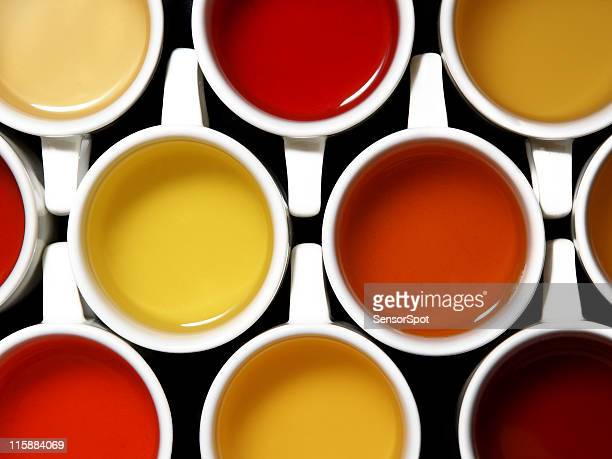 mix of teas and colours - hot tea stock pictures, royalty-free photos & images