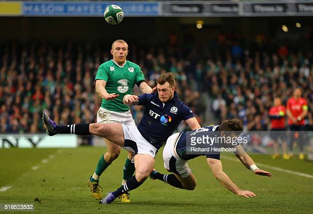 Mix up between Stuart Hogg and Tommy Seymour of Scotland gifts a try to Keith Earls of Ireland during the RBS Six Nations match between Ireland and...