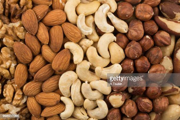 mixe of various nuts background above closeup - nut food stock photos and pictures