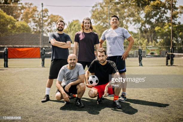 mixed age range men soccer team - amateur stock pictures, royalty-free photos & images