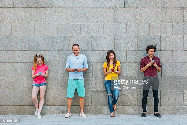 Mixed age range of people social networking