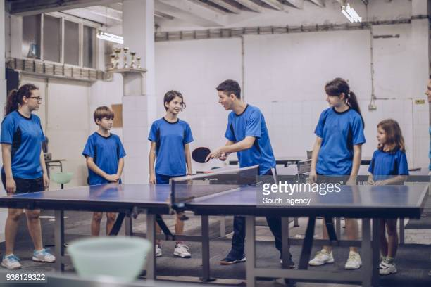 mixed age table tennis training - sports team event stock photos and pictures
