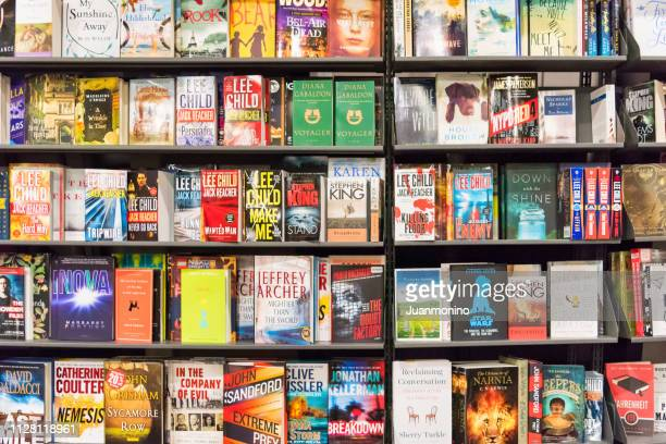 mixed assorted books for sale in a bookstore outdoors shelves - front page stock pictures, royalty-free photos & images