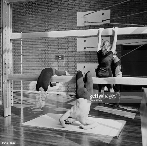 A mixed class performs rhythmic gymnastics on the new gym equipment at Nonington College of Physical Education in St Alban's Court Nonington Kent...