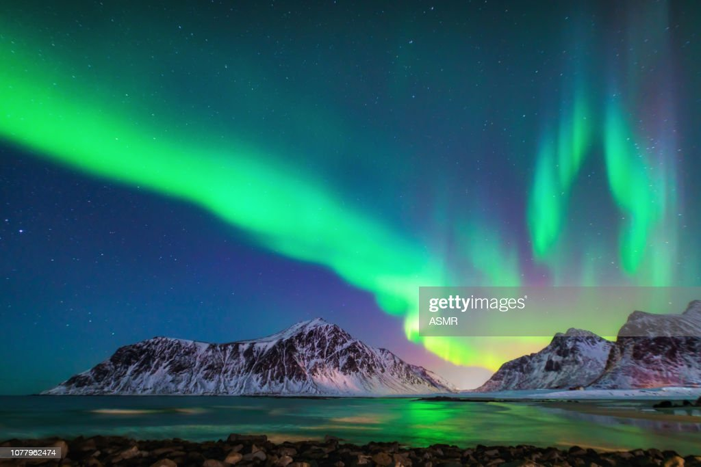 Mixed colorful aurora borealis dancing in the sky : Stock Photo