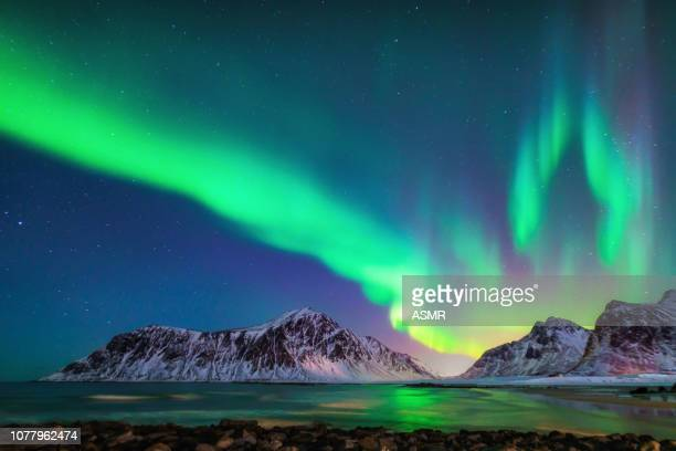 mixed colorful aurora borealis dancing in the sky - islanda foto e immagini stock