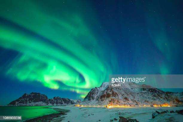 mixed colorful aurora borealis dancing in the sky - marginata stock pictures, royalty-free photos & images