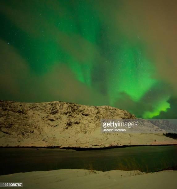 mixed colorful aurora borealis dancing in the sky - jasmin sturm stock-fotos und bilder
