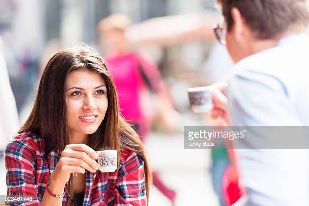 Mixed couple drinking Turkish Coffee