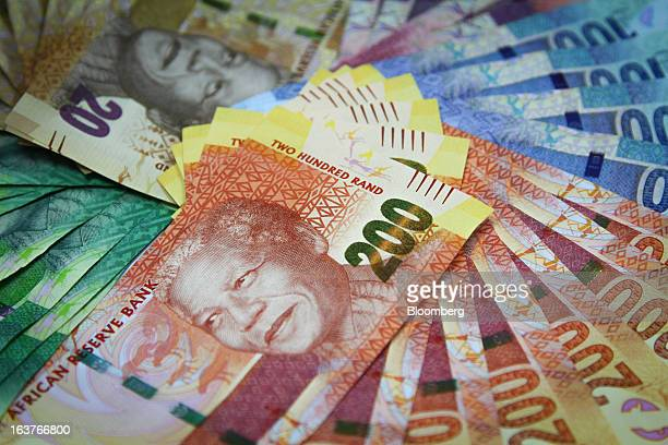 Mixed denomination rand currency banknotes are arranged for a photograph at a First National Bank branch in Johannesburg South Africa on Friday March...