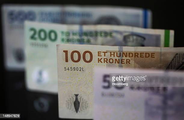 Mixed denominations of Danish kroner currency notes are seen in this arranged photograph in London UK on Friday July 20 2012 Demand for Danish kroner...