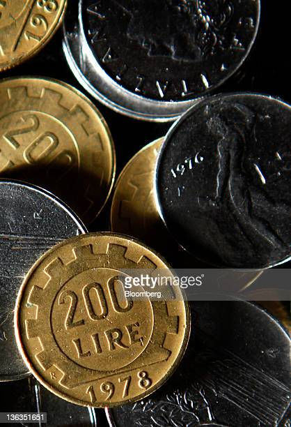 Mixed denominations of Lire coins Italy's former currency are seen in this arranged photograph in Rome Italy on Sunday Jan 1 2012 Prime Minister...