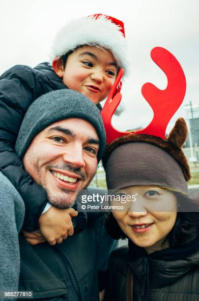 Mixed ethnicity family Christmas group shot